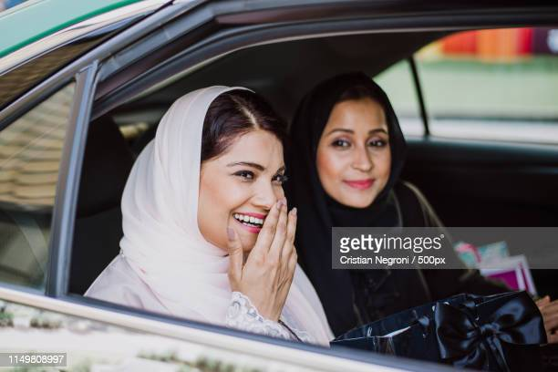 two arabian women spending time together - car interior stock pictures, royalty-free photos & images