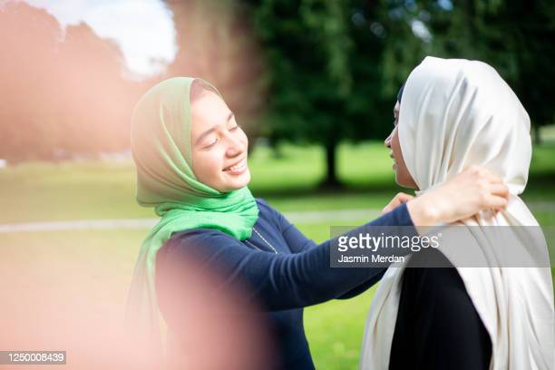 two arabic style women in park - religion stock pictures, royalty-free photos & images