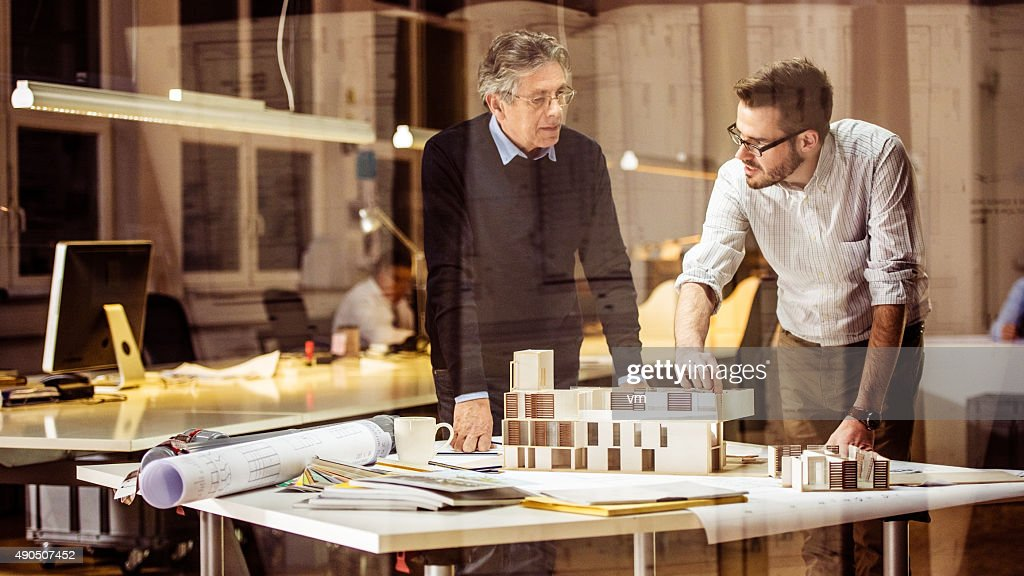 Two architects discussing new project : Stock Photo