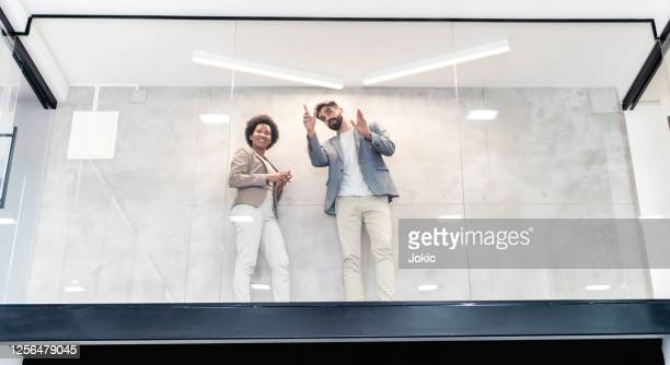 two architects in empty office stock photo - real estate developer stock pictures, royalty-free photos & images