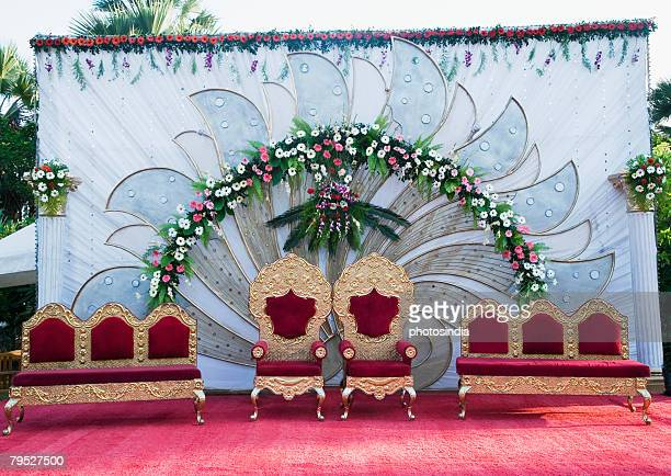 Two armchairs with couches on a wedding stage