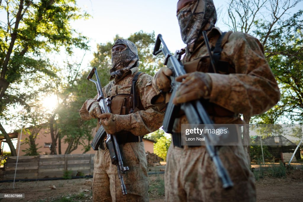 Two armed guards stand for a photo at the ranch of rhino breeder John Hume on October 16, 2017 in the North West Province of South Africa. John Hume is currently the owner of around 1500 white and black rhinos, which he keeps under armed guard on his 8000 hectare property. In a bid to prevent poaching and conserve the different species of rhino, the horns of the animals are regularly trimmed, with 264 of the off-cuts recently being placed on sale at auction. The controversial decision to sell the horns was made on the basis that the illegal market creates an inflated value, while a controlled system would lower the prices and the need to poach. Mr Hume believes that the only way to ensure that the rhino does not become extinct is through farming the animals on a large scale and legalising the sale of rhino horn globally.