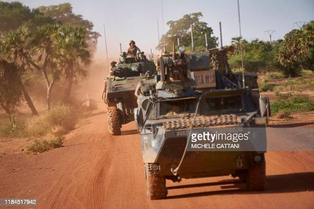 Two Armoured Personnel Carriers of the French Army patrol a rural area during the Bourgou IV operation in northern Burkina Faso on November 14, 2019....
