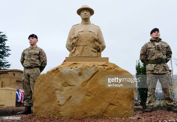 Two Army cadets stand next to a sculpture of 'Tommy' during an unveiling by former Royal Engineer and Dunkirk veteran David Evans from Leyburn who...