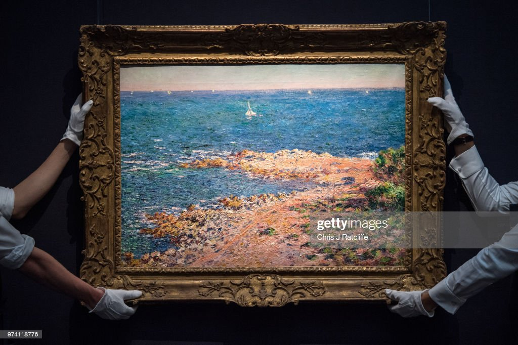 Two art handlers hang 'La Mediterranee par vent de mistral' by Claude Monet (estimated at £6.5 million to £8.5 million) during a preview of the Impressionist and Modern sale at Sotheby's on June 14, 2018 in London, England. The sale will take place on 19 June 2018 and includes works by artists Picasso, Monet, Kandinsky and Matisse.