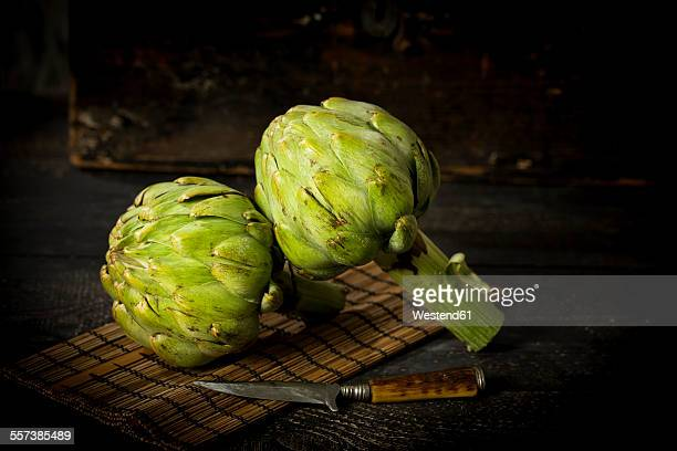 Two artichokes and a knife