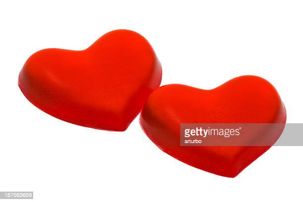 two artificial red gel hearts lined up