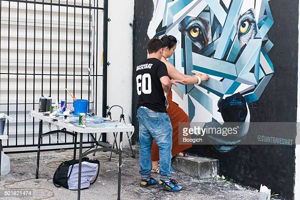 Two Artists Work Together on Mural During Hialeah Now Festival