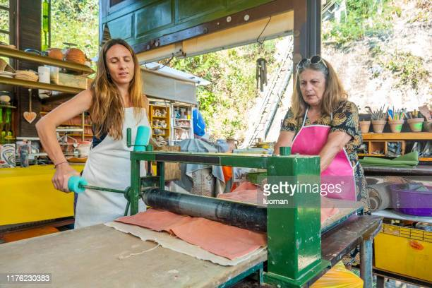 two artists working in their atelier - unripe stock pictures, royalty-free photos & images
