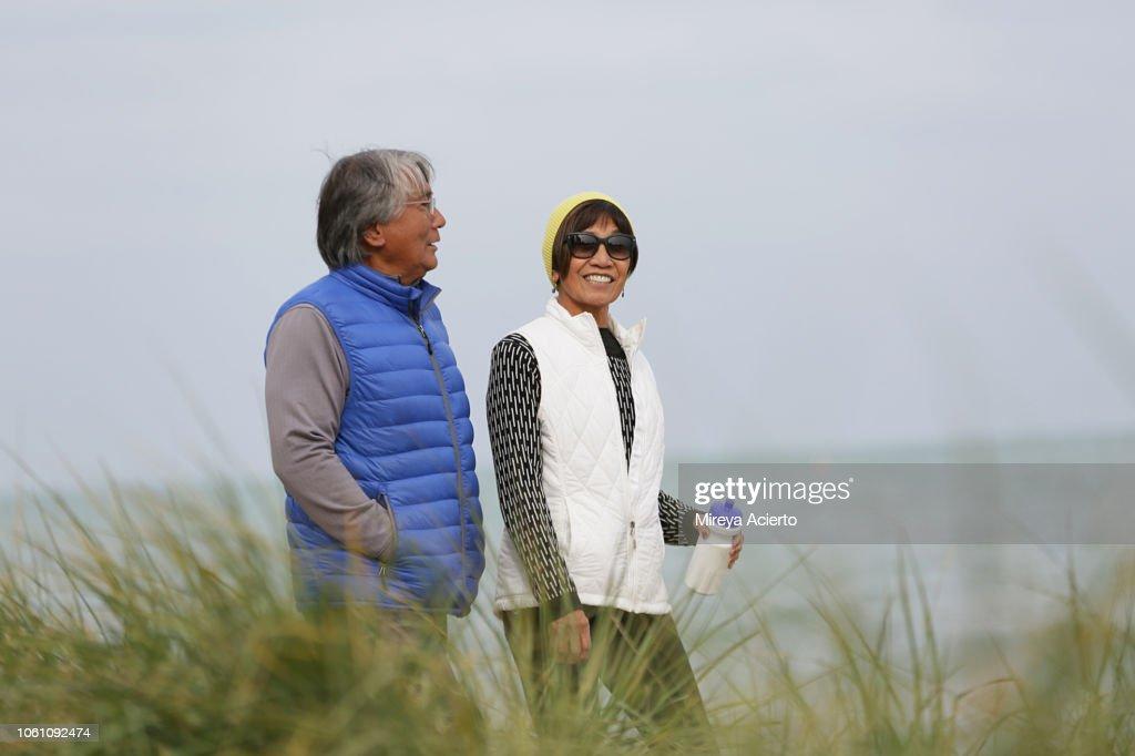 good quality sale retailer exquisite design Two Asian American Seniors Enjoy A Walk Outdoor Along The ...