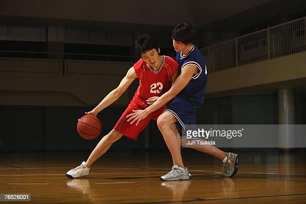 Two Asian Boys Playing Basketball