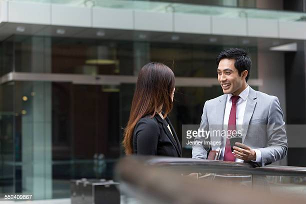 Two Asian Business people having a conversation.