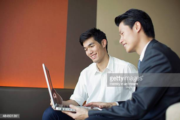 Two Asian businessmen in a meeting.