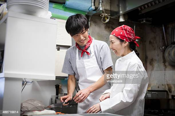 Two Asian Chefs Cooking Together