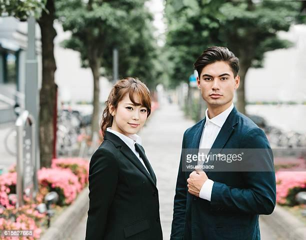 two asian entrepreneurs on the street - solapa camisa fotografías e imágenes de stock