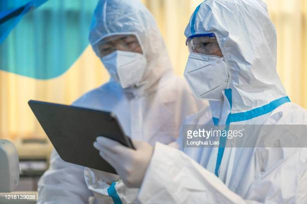 two asian male doctors do experiments in the laboratory - china coronavirus stock pictures, royalty-free photos & images