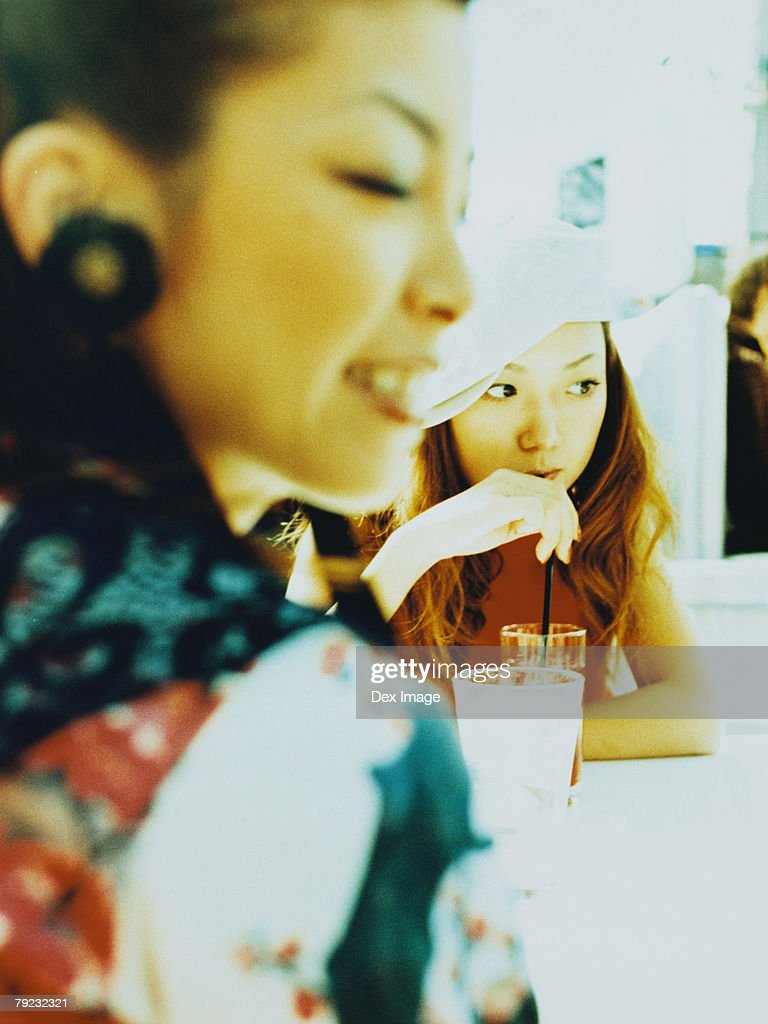 Two Asian women at a caf? : Stock Photo