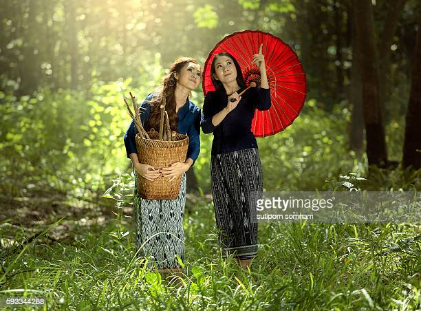Two Asian women in traditional thai dress