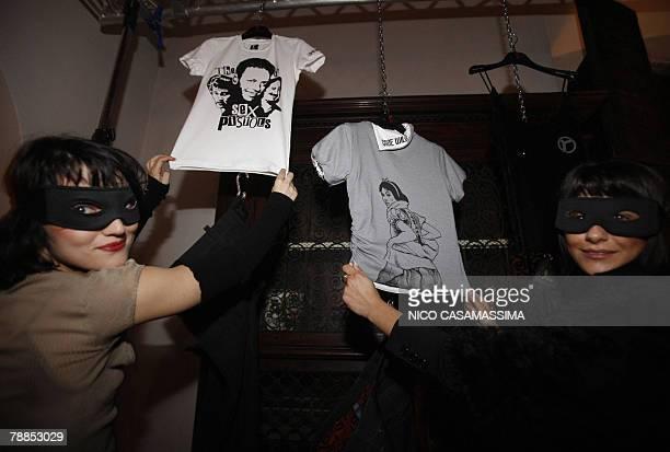 Two assistants help present former pornostar Rocco Siffredi's new fashion label Rocco during the Rocks Launch Party in Castel di Poggio at Fiesole...