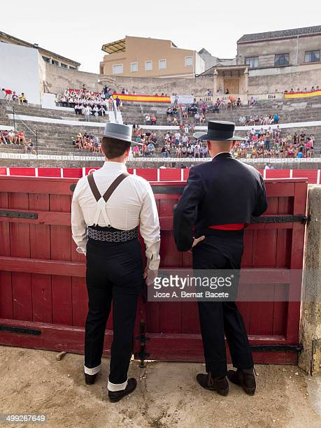 Two assistants of bullfighters dressed in outdoor suit. Bocairent, , Spain.