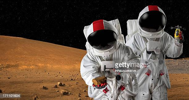 Two Astronauts on Mars Doing A Geology Study