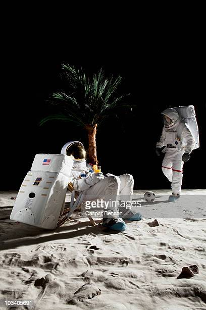 Two astronauts on the moon enjoying some leisure time