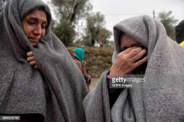 Two asylumseekers cry as they explain they cannot locate a missing relative They were outside Moria Camp during a period when hundreds of migrants...