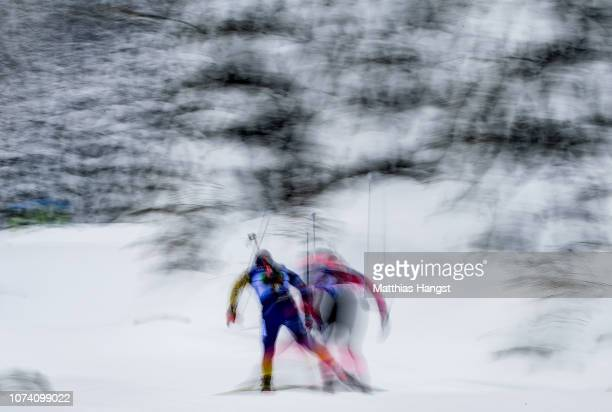 Two athletes compete in the IBU Biathlon World Cup Men's 4x75 km Relay on December 16 2018 in Hochfilzen Austria