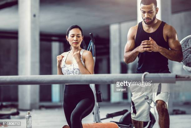 Two Athletes Exercising in a Gym