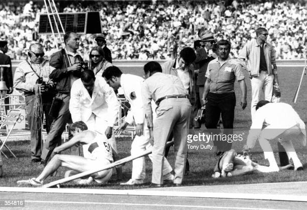 Two athletes fall victim to the high altitudes of the ''68 Olympics in Mexico City. Mandatory Credit: Tony Duffy/ALLSPORT