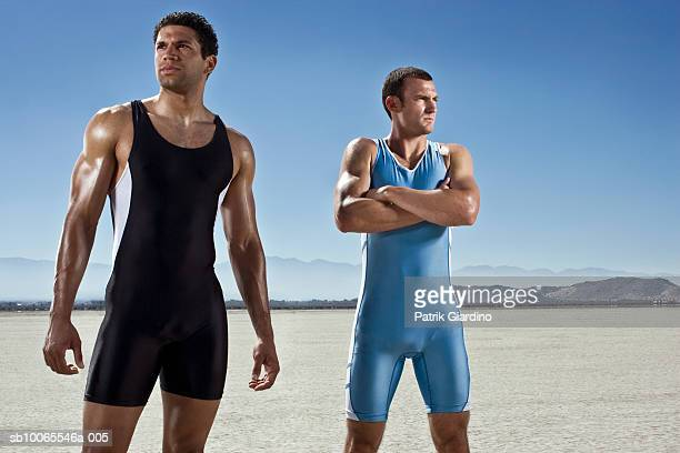 two athletes standing on dry lake - el mirage dry lake stock photos and pictures