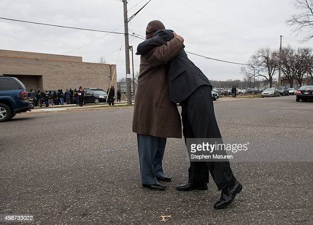 Two attendees embrace outside the funeral service of Jamar Clark at Shiloh Temple on November 25 2015 in Minneapolis Minnesota Activists are keeping...