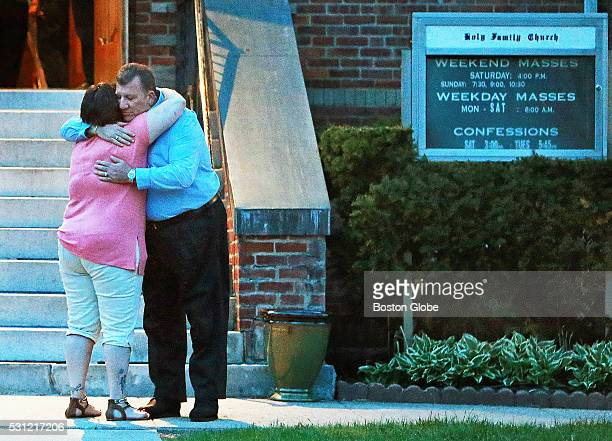Two attendees hug leaving the Holy Family Catholic Church after a vigil for the victims of a stabbing spree the day before in Taunton Mass May 12 2016
