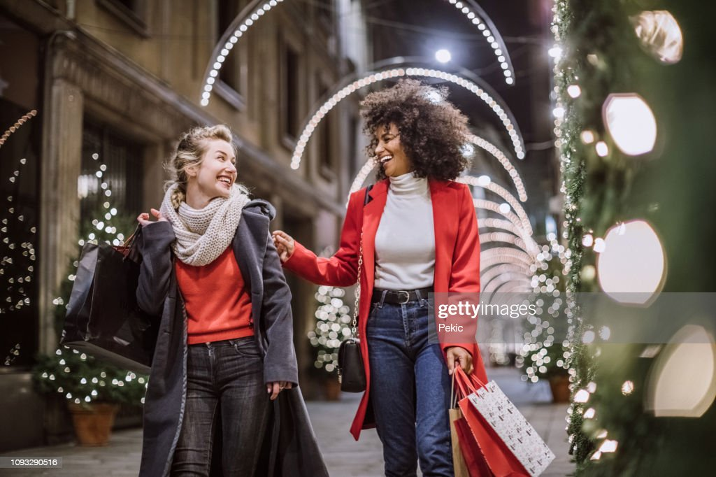 Two Attractive Young Women In Christmas Shopping : Stock Photo