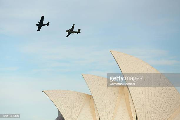 Two Australian Air Force planes fly over the Sydney Opera House during a 'Salute To Navy' Air Display on October 5 2013 in Sydney Australia Over 50...