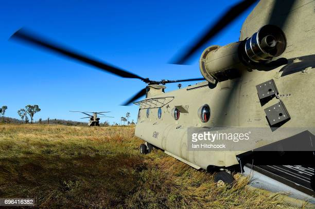 Two Australian Army CH47 Chinook helicopters are seen on a landing zone during the 3rd Brigade Live Fire Exercise 'Brolga Strike' on June 16 2017 in...
