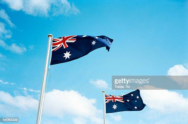 two australian flags blowing in the breeze - australian flag stock pictures, royalty-free photos & images
