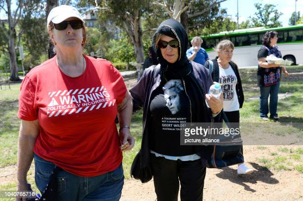 Two Australian protestors pose with their tshirts in Canberra Australia 06 February 2016 one reads 'Warning politically incorrect' Six conservative...