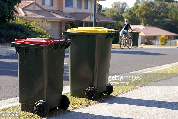 two australian rubbish bins red is rubbish, yellow is recycling - garbage bin stock pictures, royalty-free photos & images