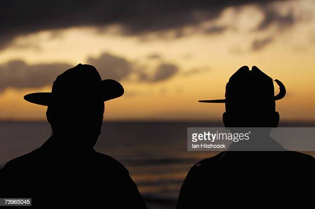 Two Australian soldiers are seen during an ANZAC day commemorative dawn service at Balgal Beach April 25, 2007. Australians and New Zealanders today...