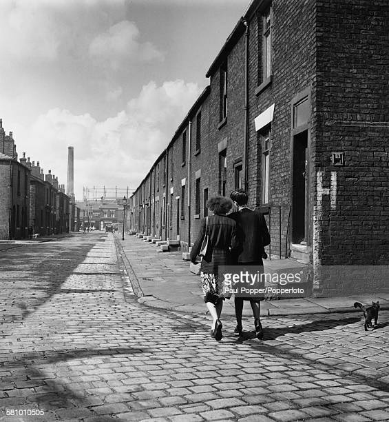 Two Austrian cotton mill workers on a street in Bolton Lancashire November 1948