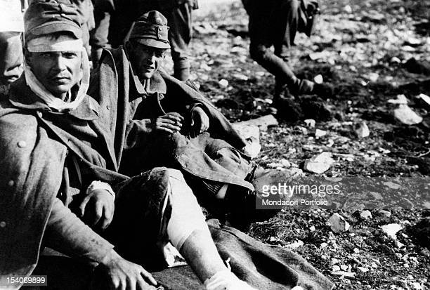 Two Austrian soldiers suffering some injuries after a battle with the Troops of the Entente in which they have been captured. Treviso, October 1918