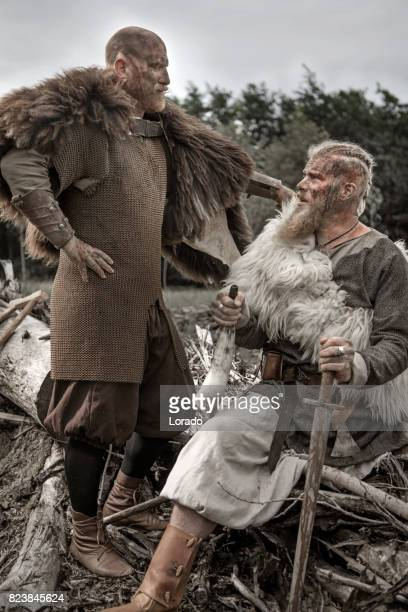 Two Authentic Caucasian Bearded Viking Warriors in Outdoor Forest Setting