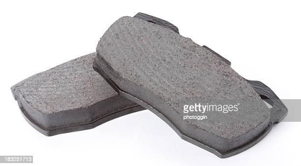 Two Automotive Brake Pads