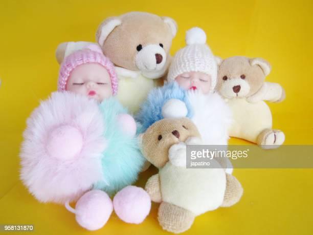 two babies among teddy bears - named animal ストックフォトと画像