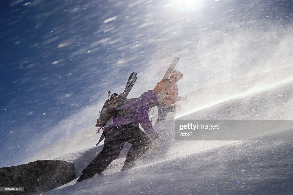 Two back country riders breaking a trail upwards : Stock Photo