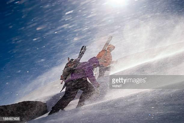 two back country riders breaking a trail upwards - inspanning stockfoto's en -beelden