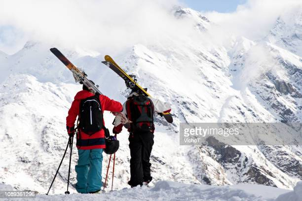 two back country skiers standing in front of high mountain peaks - monte rosa foto e immagini stock