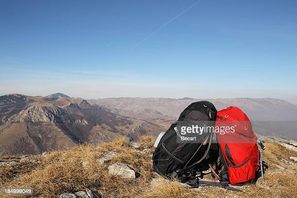 Two Backpacks at the Top of Mountain
