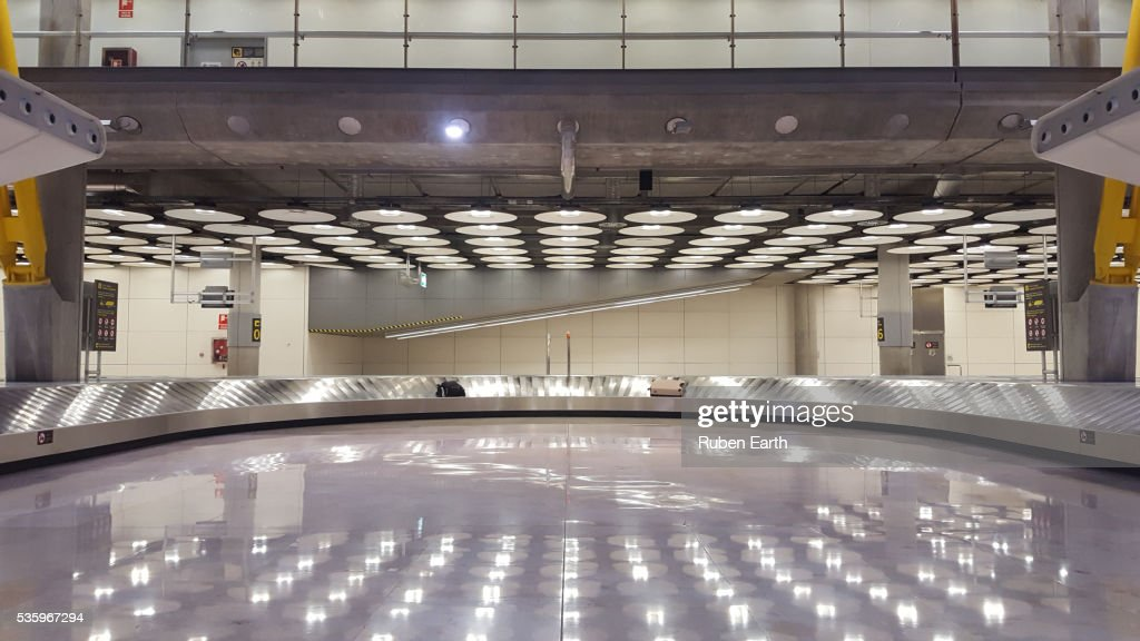 Two bags lost at the airport over the Baggage belt : Stock Photo